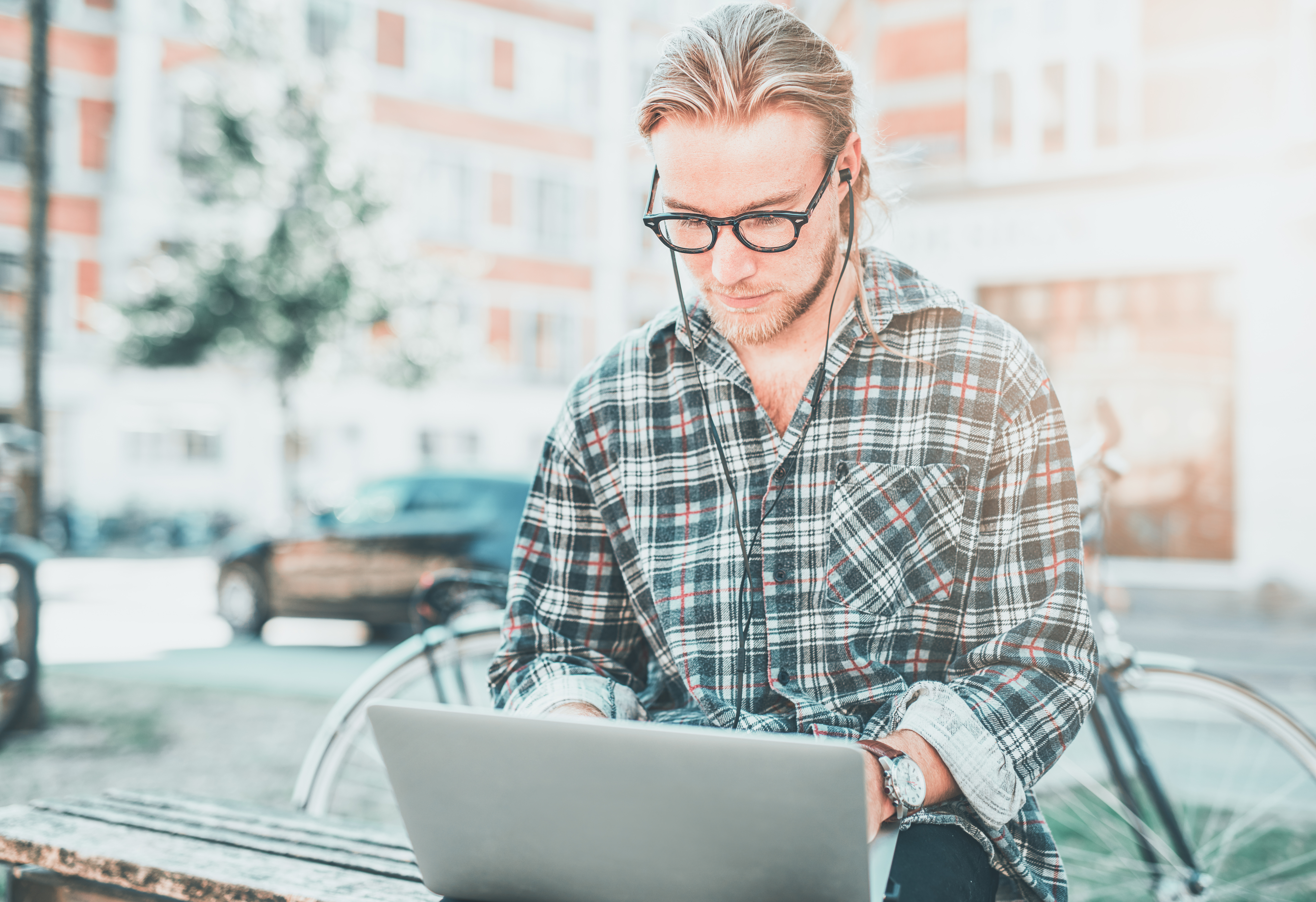 concentrated-young-man-with-his-laptop-PU7YVZA